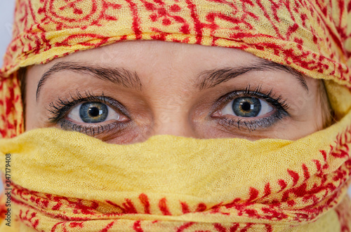 Female eyes, yellow burqa face in patterns Canvas Print