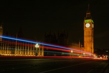 Multi Colored Light Trails On Street Leading Towards Big Ben At Night