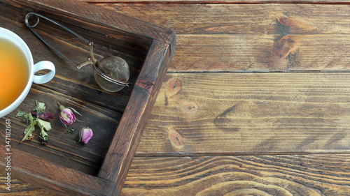 Fotografie, Obraz A cup of herbal tea and dry leaves of lemon balm, linden, verbena, lavender and