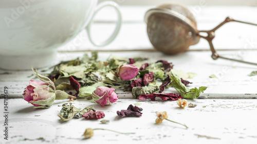 Fotografija Herbal tea - lemon balm, linden, verbena, rosebuds, lavender, a white cup and te