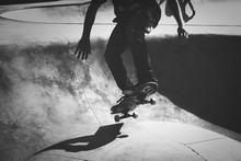 Low Section Of Man Skateboardi...