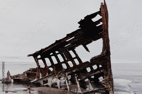 Canvas Print Shipwreck At Sea Shore During Foggy Weather