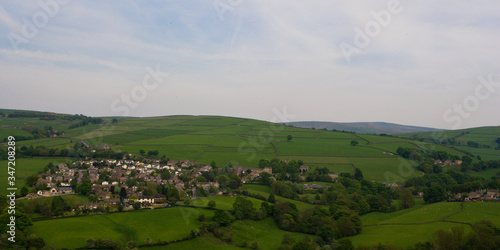 Fototapeta View of small rural British village and surrounding hills from a distance