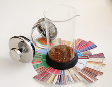 French Press With Ground Coffee. On Coffee Taster's Flavor Wheel. White Background