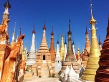 Stupas Against Blue Sky