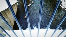 High Angle View Of Dam Seen Through Railing