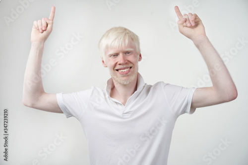 Photo portrait of an albino man in studio dressed t-shirt isolated on a white background