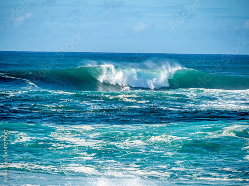 Photo Surfers attempt to ride the big waves of Oahu's North Shore.