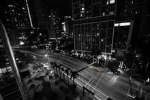 High Angle View Of Yellow Taxi On Road Against Buildings At Night