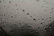 Full Frame Shot Of Raindrops On Glass Window