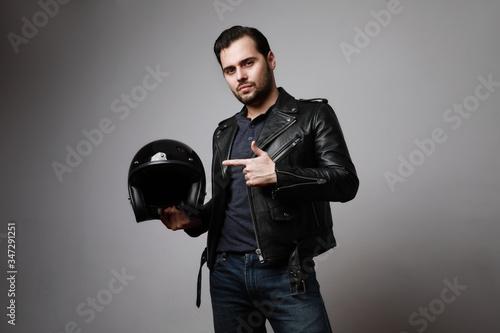 Headshot brutal bearded biker man wears helmet and dressed in a black leather jacket Tapéta, Fotótapéta