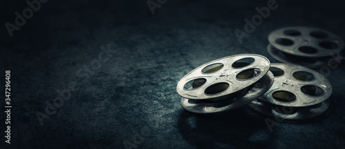 Fotografie, Tablou 3D rendering of movie reels on a dark blue surface