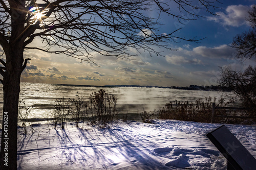 Scenic View Of Sea Against Sky During Winter Canvas Print