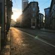 View Of Tram Tracks On Street Along Buildings
