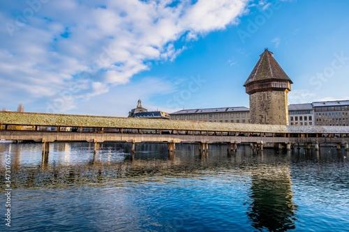 Photo Bridge Over River Against Buildings