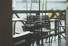 Empty Chairs And Table At Sidewalk Cafe