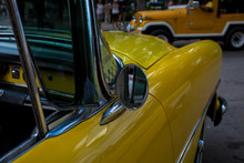 High Angle View Of Vintage Yellow Taxi On Street In City