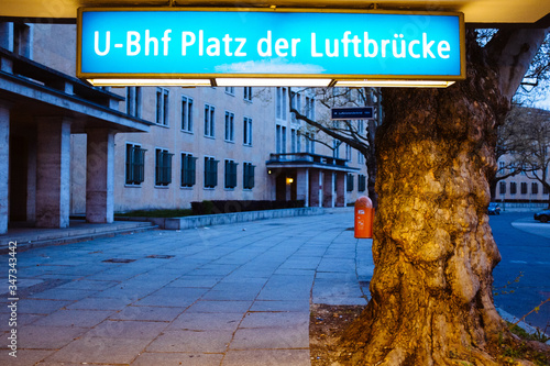 Illuminated Sign By Tree Trunk Outside Platz Der Luftbrucke Canvas Print