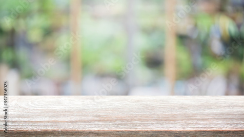 Fotografie, Obraz Empty wood table top and blur glass window interior restaurant banner mock up abstract background - can used for display or montage your products