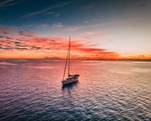 Sailboat Shot At Sunrise