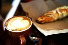 Close-up Of Cappuccino And Pastry