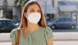 canvas print picture - COVID-19 Pandemic Coronavirus Woman in city street wearing KN95 FFP2 mask protective for spreading of disease virus SARS-CoV-2. Girl with protective mask on face against Coronavirus Disease 2019.