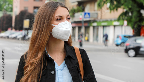 Canvas Print COVID-19 Pandemic Coronavirus Woman in city street wearing KN95 FFP2 mask protective for spreading of disease virus SARS-CoV-2