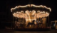Illuminated Merry-go-round At Night