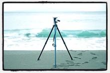 Camera Tripod On Beach