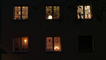 Low Angle View Of Illuminated House Windows At Night