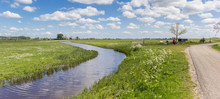 Panorama Of A Small River Going Through The Flat Dutch Landscape In Groningen, Netherlands