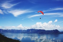 Scenic View Of A Paraglider In Sky