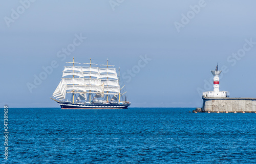 Seascape with sailing ship. White sailing vessel floating in the sea. Copy space. The concept of calmness, silence and unity with nature. © panophotograph
