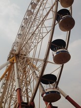 Low Angle View Of Ferris Wheel...