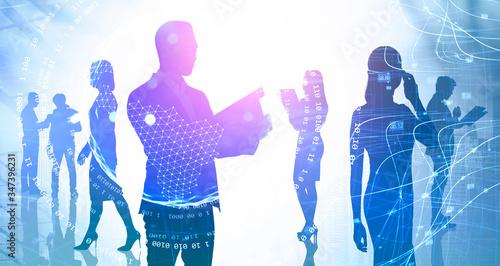 Fotografía Man with clipboard and his team, internet