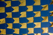 Full Frame Shot Of Yellow Flags Against Blue Sky During Festa Junina