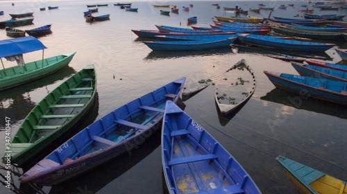 Fotografiet High Angle View Of Rowboats Moored In Phewa Lake