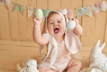 Cute Funny Baby With Bunny Ear. Easter Greeting Card, Copyspace For Your Text. Poster For Easter Holiday. Easter Bunny. Congratulations On Mother's Day. Easter Rabbit.Children's Day