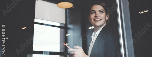 Fototapeta Portrait of charming business lady working in big open space office. Wide screen, panoramic obraz