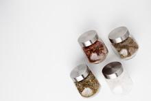 Seasoning In Jars On A White B...