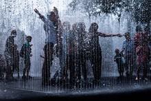People Enjoying In Fountain