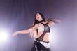 Leinwanddruck Bild - Spirituality dance. Beautiful sexy woman with luxury glossy eastern make-up dancing tribal fusion. Belly dance.