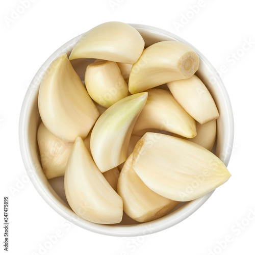 Fototapeta Garlic cloves in bowl from top isolated on white background including clipping p