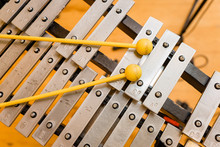 A Xylophone And Sticks In A Mu...