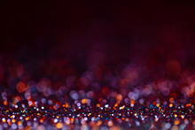 Decoration Bokeh Glitters Background, Abstract Shiny Backdrop With Circles,modern Design Wallpaper With Sparkling Glimmers. Purple, Red, Golden And Black Backdrop Glittering Sparks With Glow Effect
