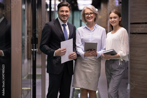 Diverse staff members confident smile business team holding document notepad and Fotobehang