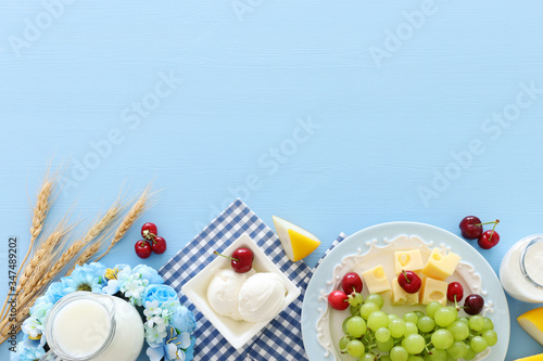 Obraz Top view photo of dairy products over pastel blue background. Symbols of jewish holiday - Shavuot - fototapety do salonu