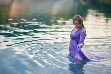 Girl In Bodycon Dress Bathes I...