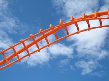 Low Angle View Of Rollercoaster Against Sky