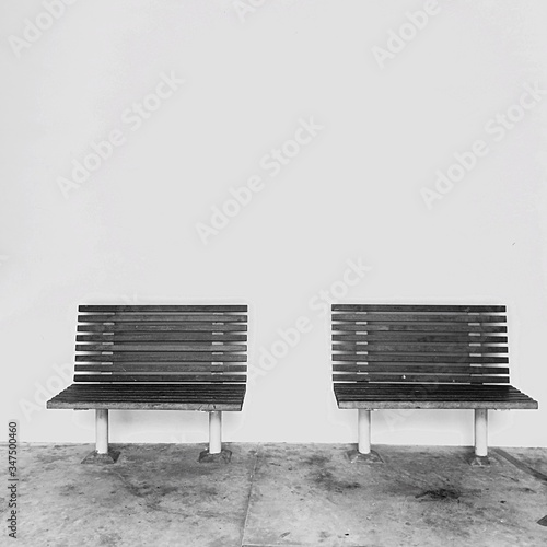 Obraz na plátně Empty Benches Against The Wall